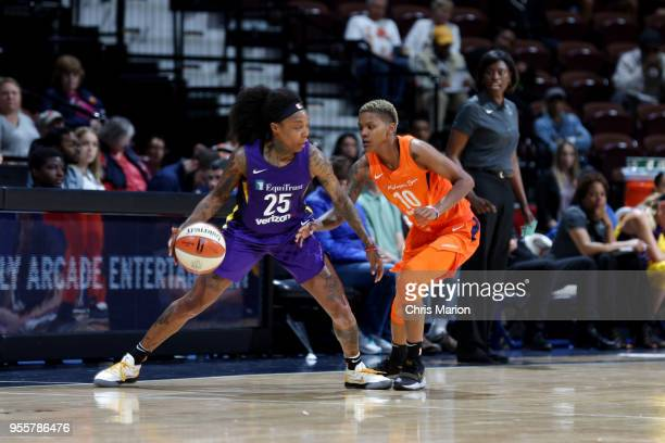 Cappie Pondexter of the Los Angeles Sparks handles the ball against the Connecticut Sun during a preseason game on May 7 2018 at Mohegan Sun Arena in...
