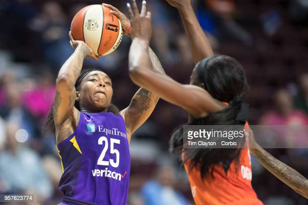 Cappie Pondexter of the Los Angeles Sparks shoots while defended by Chiney Ogwumike of the Connecticut Sun during the Connecticut Sun Vs Los Angeles...