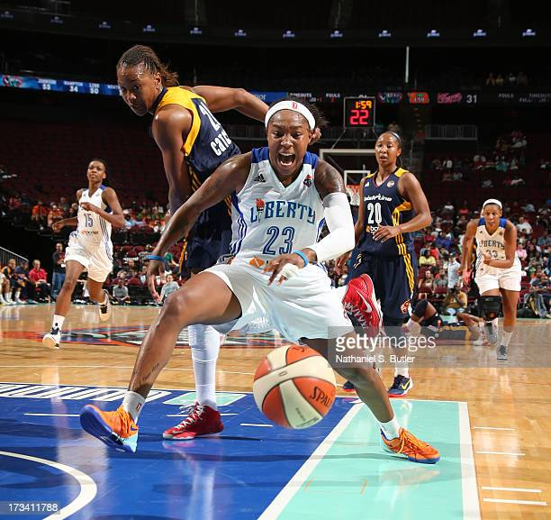 Cappie Pondexter of the New York Liberty battles for the ball during a game against Tamika Catchings of the Indiana Fever during a game on July 13...