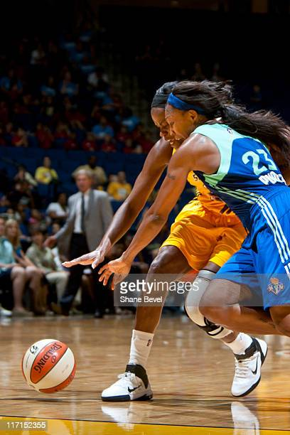 Cappie Pondexter of the New York Liberty collides with Ivory Latta of the Tulsa Shock while chasing a loose ball during the WNBA game on June 23 2011...