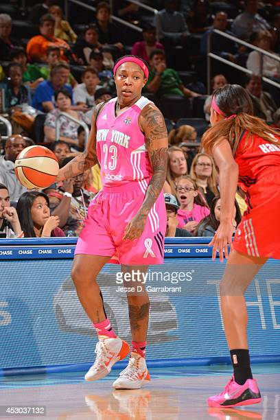Cappie Pondexter of the New York Liberty controls the ball against the Washington Mystics on July 29 2014 at Madison Square Garden in New York New...
