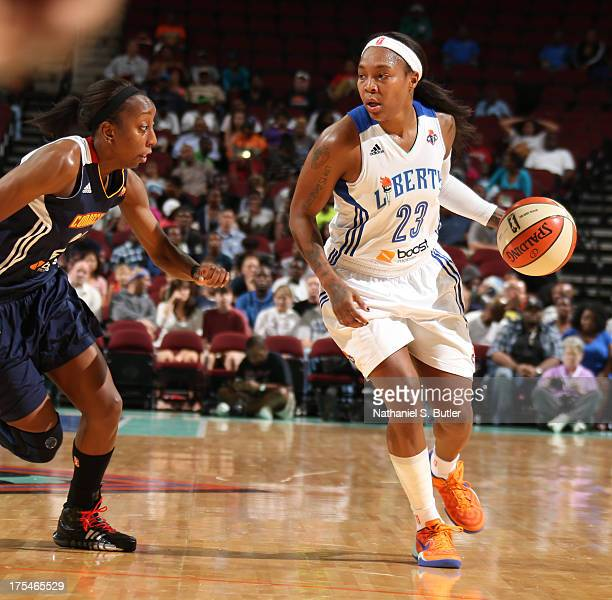 Cappie Pondexter of the New York Liberty drives against Allison Hightower of the Connecticut Sun during a game on August 3 2013 at the Prudential...