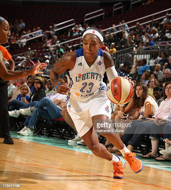Cappie Pondexter of the New York Liberty drives against Briann January of the Indiana Fever during a game on July 13 2013 at the Prudential Center in...
