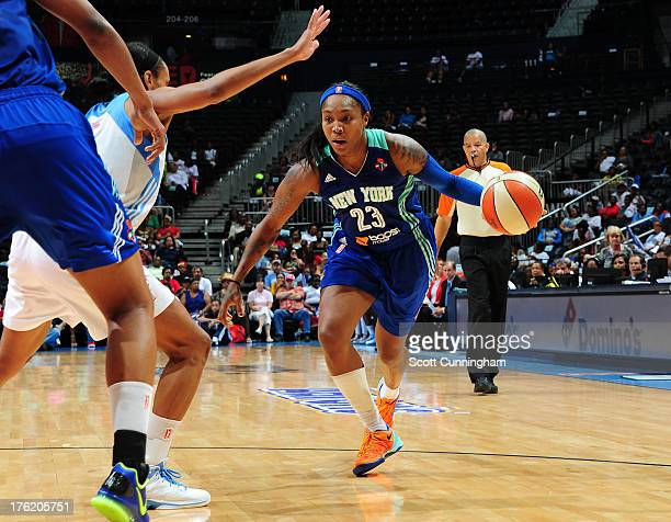 Cappie Pondexter of the New York Liberty drives against the Atlanta Dream at Philips Arena on August 11 2013 in Atlanta Georgia NOTE TO USER User...