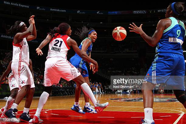 Cappie Pondexter of the New York Liberty passes against Nicky Anosike of the Washington Mystics at the Verizon Center on August 6 2011 in Washington...