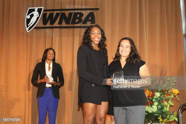 Cappie Pondexter of the New York Liberty receives an award during the WNBA Inspiring Women Luncheon at Pier Sixty at Chelsea Piers on September 10...