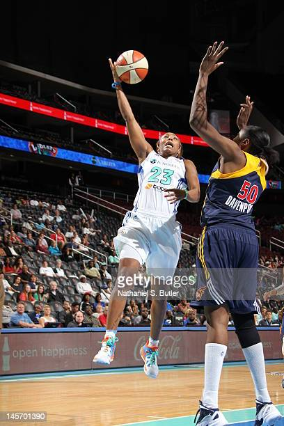 Cappie Pondexter of the New York Liberty shoots against Jessica Davenport of the Indiana Fever during a game on June 3 2012 at the Prudential Center...