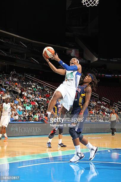Cappie Pondexter of the New York Liberty shoots against Shavonte Zellous of the Indiana Fever during a game on August 30 2012 at the Prudential...