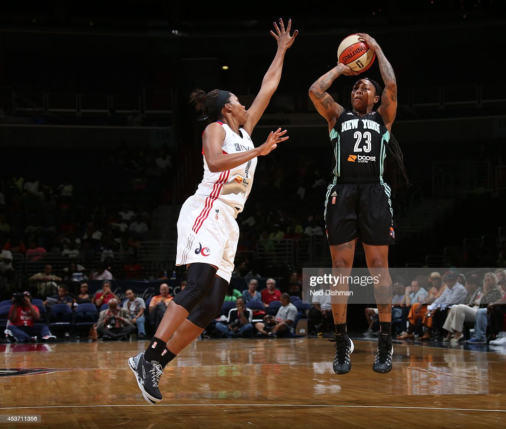 Cappie Pondexter #23 of the New York Liberty shoots the ball against Tayler Hill #4 of the Washington Mystics at the Verizon Center on August 16, 2014 in Washington, DC.