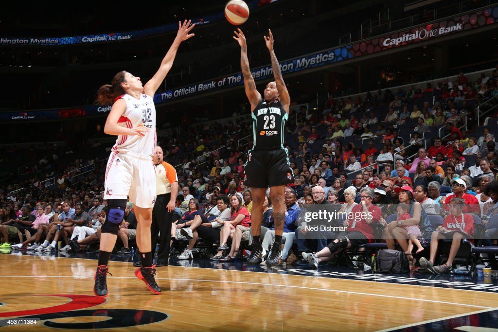 Cappie Pondexter #23 of the New York Liberty shoots the ball against Jelena Milovanovic #32 of the Washington Mystics at the Verizon Center on August 16, 2014 in Washington, DC.