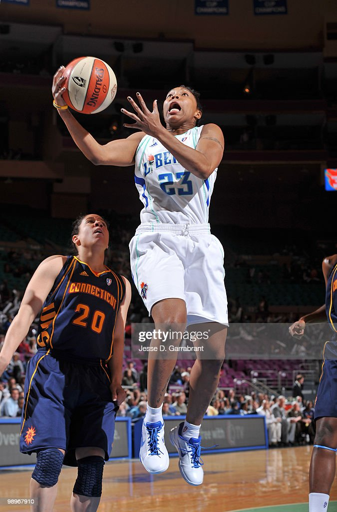 Cappie Pondexter #23 of the New York Liberty shoots the basketball against Kara Lawson #20 of the Connecticut Sun during the preseason WNBA game on May 11, 2010 at the Madison Square Garden in New York City.