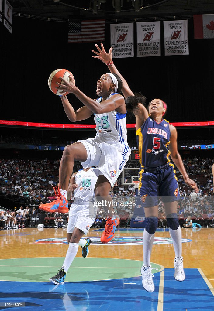 Cappie Pondexter #23 of the New York Liberty shoots the basketball against Tangela Smith #5 of the Indiana Fever in Game Two of the Eastern Conference Semifinals during the WNBA Playoffs on September 17, 2011 at the Prudential Center in Newark, New Jersey.