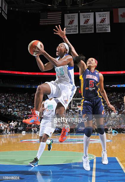 Cappie Pondexter of the New York Liberty shoots the basketball against Tangela Smith of the Indiana Fever in Game Two of the Eastern Conference...