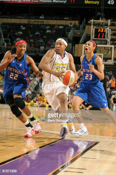 Cappie Pondexter of the Phoenix Mercury drives against Alexis Hornbuckle and Plenette Pierson of the Detroit Shock on June 14 at US Airways Center in...