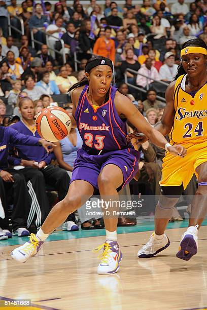 Cappie Pondexter of the Phoenix Mercury drives the baseline against Marie FerdinandHarris of the Los Angeles Sparks on June 6 2008 at Staples Center...
