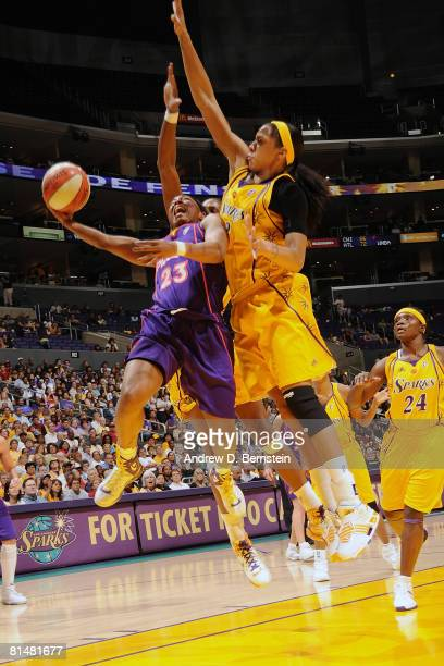 Cappie Pondexter of the Phoenix Mercury goes to the basket against Candace Parker of the Los Angeles Sparks on June 6 2008 at Staples Center in Los...