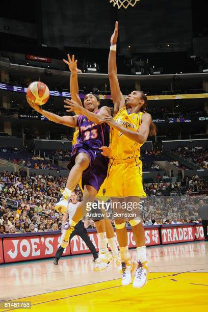 Cappie Pondexter of the Phoenix Mercury goes to the basket against Lisa Leslie of the Los Angeles Sparks on June 6 2008 at Staples Center in Los...