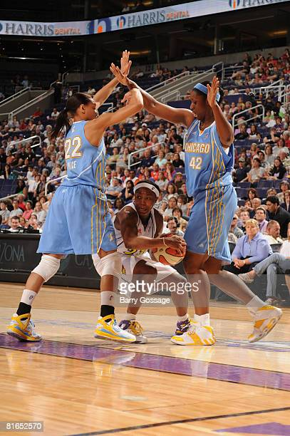 Cappie Pondexter of the Phoenix Mercury looks to pass against Armintie Price and Tye'sha Fluker of the Chicago Sky on June 20 at U.S. Airways Center...