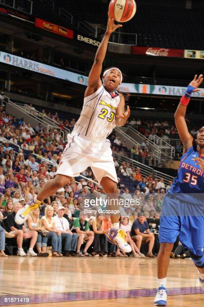 Cappie Pondexter of the Phoenix Mercury shoots against Cheryl Ford of the Detroit Shock on June 14 at US Airways Center in Phoenix Arizona NOTE TO...
