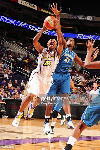 Cappie Pondexter of the Phoenix Mercury shoots against Nicky Anosike of the Minnesota Lynx at US Airways Center September 3 2008 in Phoenix Arizona...
