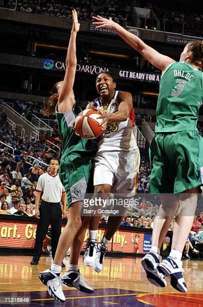 Cappie Pondexter of the Phoenix Mercury shoots against Nicole Ohlde of the Minnesota Lynx in a WNBA game played on June 28 at U.S. Airways Center in...