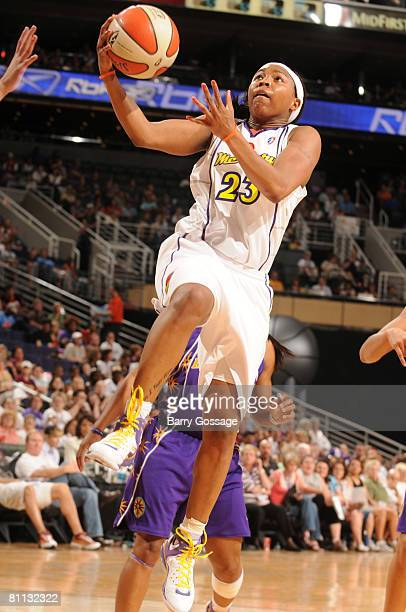 Cappie Pondexter of the Phoenix Mercury shoots against the Los Angeles Sparks in an WNBA game on May 17 at US Airways Center in Phoenix Arizona NOTE...