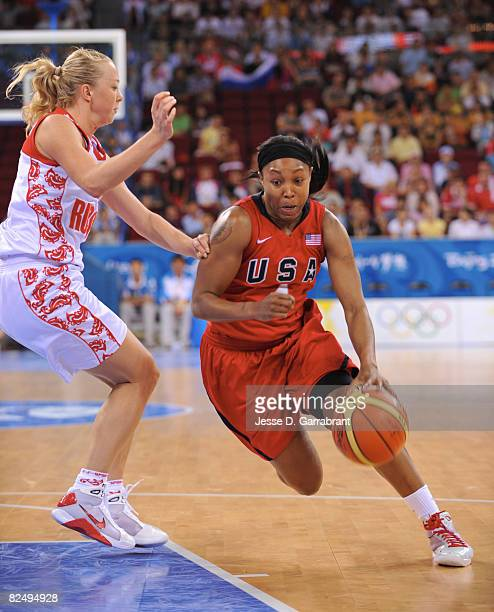 Cappie Pondexter of the U.S. Women's Senior National Team drives against Russia during the women's semifinals basketball game at the 2008 Beijing...