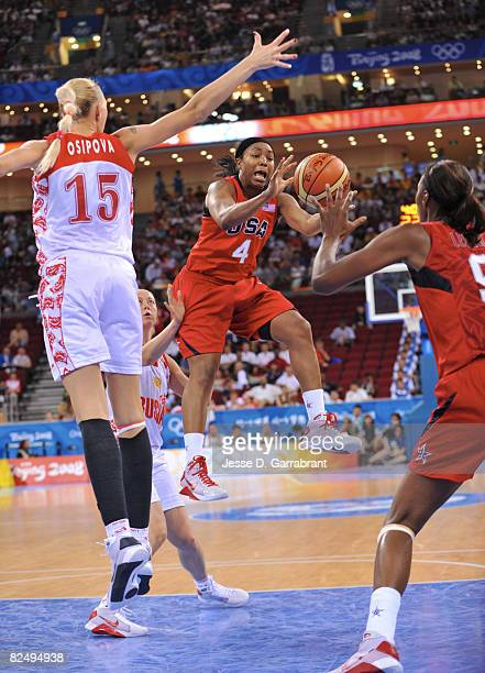 Cappie Pondexter of the U.S. Women's Senior National Team passes against Irina Osipova of Russia during the women's semifinals basketball game at the...