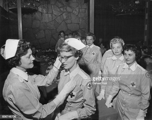Capping Time for Gray Ladies Mrs G Doyle Wyscaver 800 S Garfield St Gray Lady chairman for the Arapahoe County Red Cross presents cap and pin to Mrs...