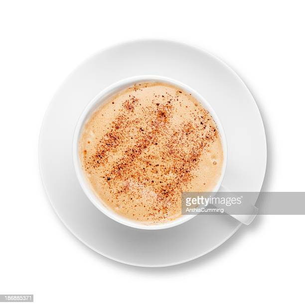 Cappuccino coffee in a white cup with saucer
