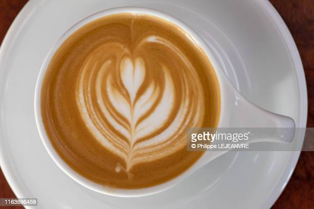 cappuccino cup on a wooden table - cappuccino stock pictures, royalty-free photos & images