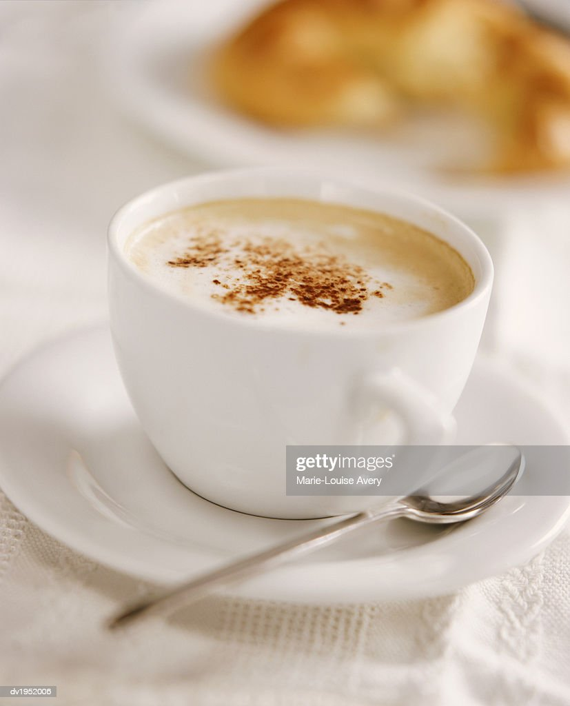 Cappuccino in a Coffee Cup With a Spoon : Stock Photo