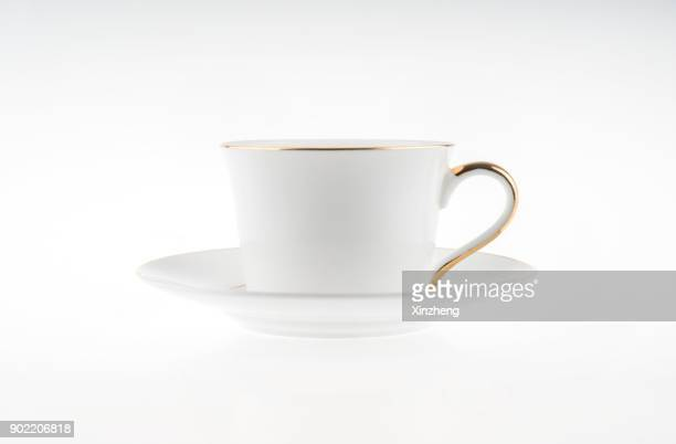 cappuccino in a white mug on a saucer, white background - porcelain stock pictures, royalty-free photos & images