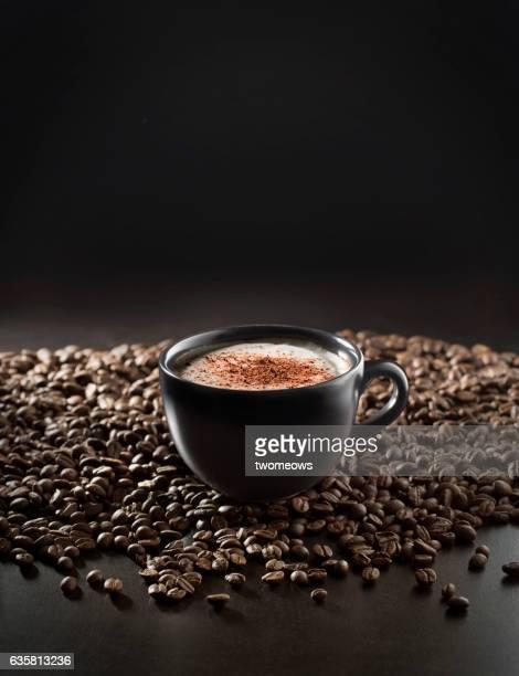 Cappuccino in black mug.
