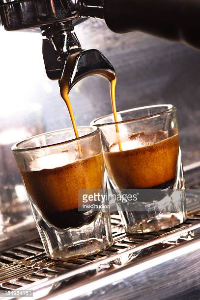 Cappuccino Machine pouring into two shot glasses.