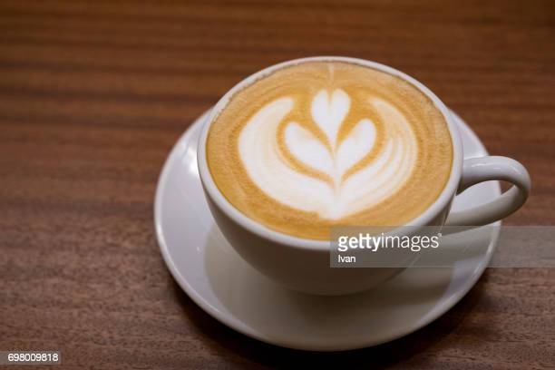 cappuccino - one cup with decorated foam, latte art - drawing artistic product stock pictures, royalty-free photos & images