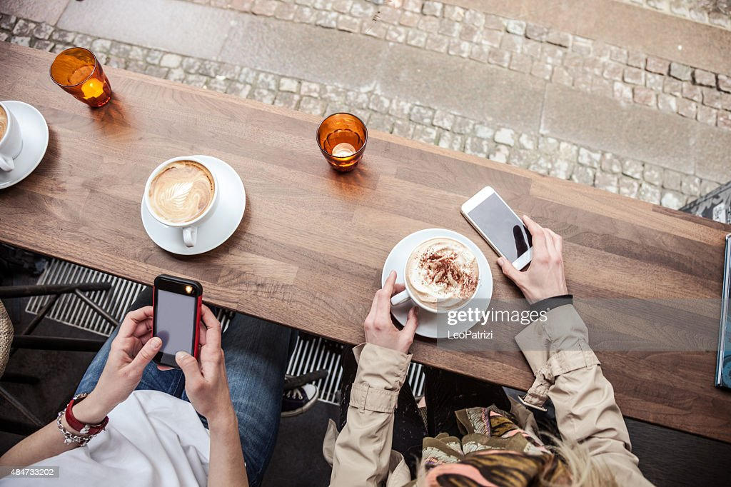 Cappuccino served on a cafe table in Copenhagen - Denmark : Stock Photo