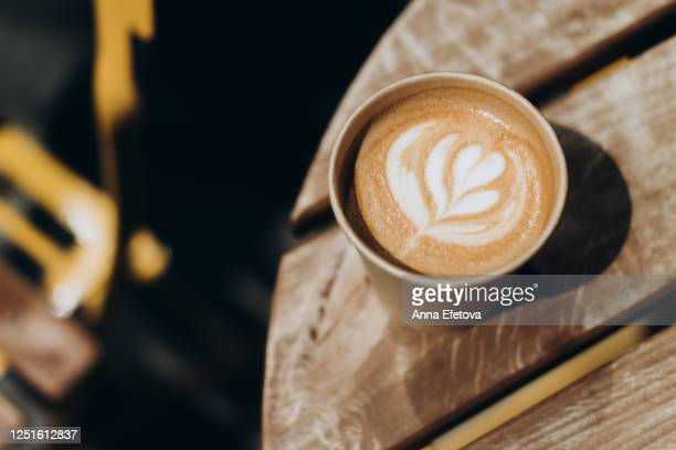 cappuccino take away with latte art - 使い捨て製品 ストックフォトと画像