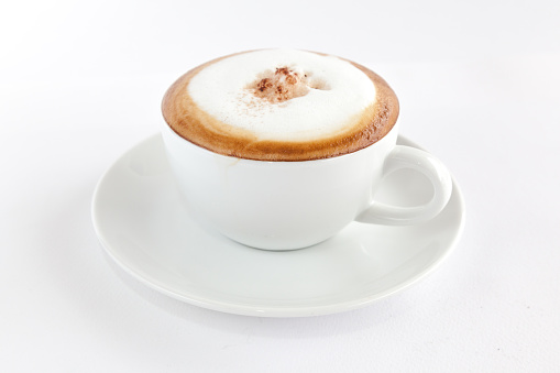 cappuccino with coffee beans 523168818