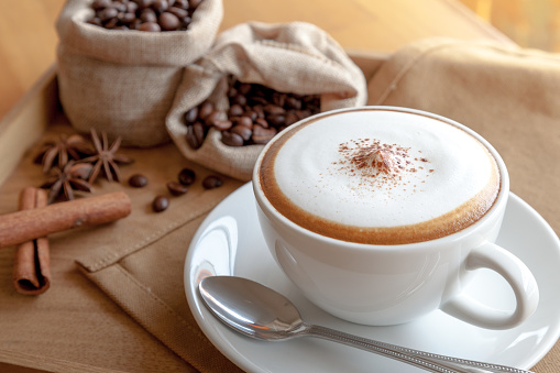 cappuccino with coffee beans 523168994