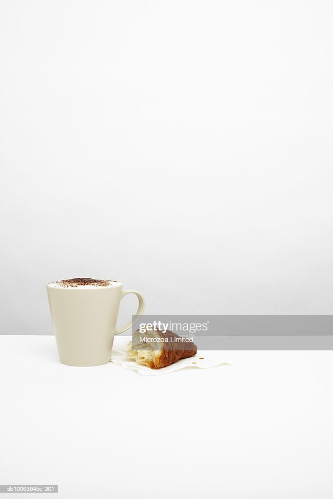 Cappuccino with croissant on table : Stock Photo