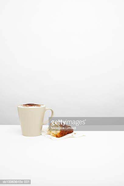 cappuccino with croissant on table - microzoa stock pictures, royalty-free photos & images