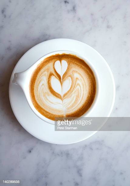 Cappuccino with heart shape on surface of foam