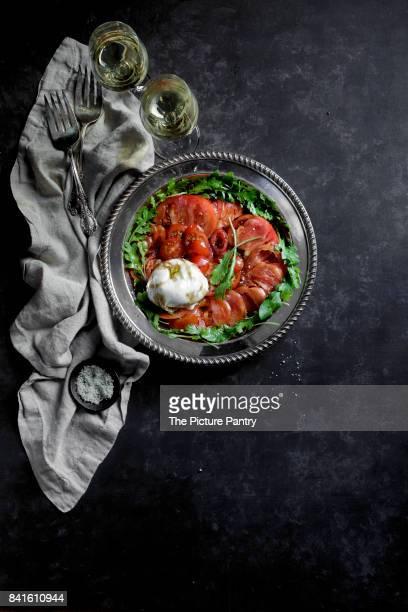 Caprese Salad on a black background
