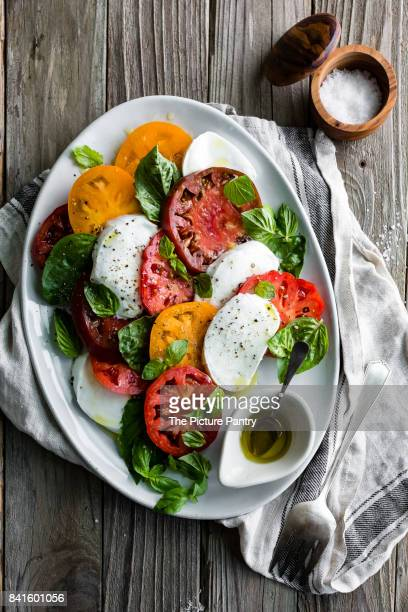 Caprese Salad on a rustic wooden background