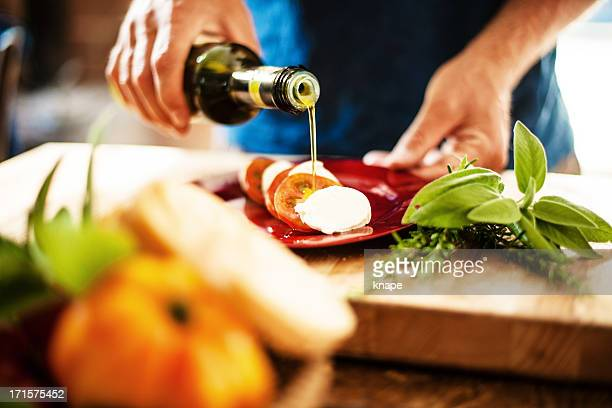 caprese salad - olive oil stock pictures, royalty-free photos & images