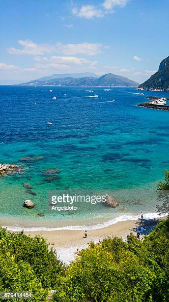 capri beach with people - sorrento stock pictures, royalty-free photos & images