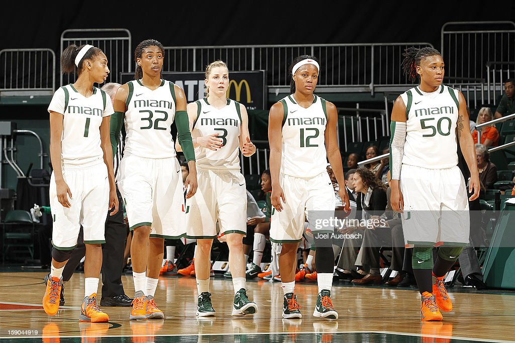 Caprice Dennis #1, Morgan Stroman #32, Stefanie Yderstrom #3, Krystal Saunders #12, and Maria Brown #50 of the Miami Hurricanes come back onto the court after a time out against the Virginia Cavaliers on January 6, 2013 at the BankUnited Center in Coral Gables, Florida. The Hurricanes defeated the Cavaliers 58-52.