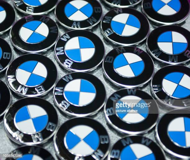 Caps With The Logo Of Bmw Lie In A Box At The Factory Of Car News