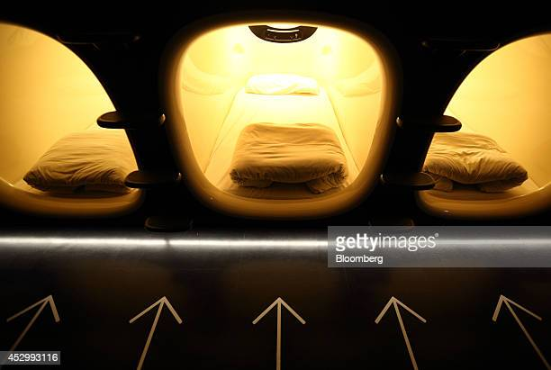 Capsule units stand in the Nine Hours Narita Airport capsule hotel operated by nine hours Inc at Narita Airport in Narita Japan on Thursday July 31...